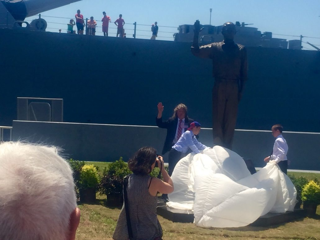 "Dr. Barry Booth unveiling ""The Recruit"" statue by Casey Downing. It is at the USS Alabama."